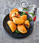 Brazilian pastries filled with chicken and peppers