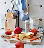 A kitchen scene – red apples being sliced