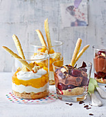 Mango and chocolate layered desserts in glasses