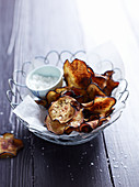 Aubergine crisps with salt in a wire basket