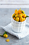 Kumquats in a white bowl