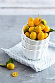 Kumquats in a white bowl