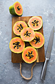 Papaya slices on a chop board