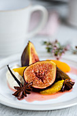 Baked figs and oranges in agave syrup