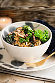 Barley risotto with mushrooms and kale