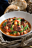Butter bean stew with chorizo and spinach pesto