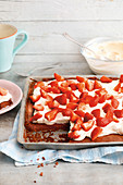 Quick chocolate strawberry cake with Greek yoghurt on a baking tray