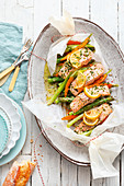 Oven-baked asparagus and salmon parcels
