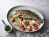 Oven-baked herb trout with fennel and cherry tomatoes
