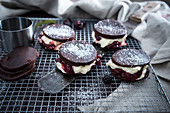 Vegan chocolate cakes filled with vanilla cream and blackberry mousse