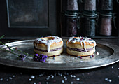 Vegan, oven-baked doughnuts with lavender cream and icing