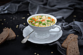 Vegan soup with star pasta and vegetables