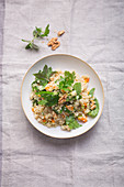 Herb salad with quinoa and walnuts