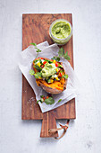 Baked sweet potato with guacamole