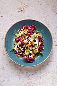 Chicory and radicchio salad with dried fruit and pumpkin seeds