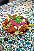 Falafel with tahini sauce (street food)