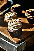 chocolate cupcakes with nut frosting to take away