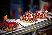 Waffles with strawberries, cream and chocolate to take away