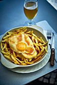 Francesinha (street food with chips and fried egg from Portugal)