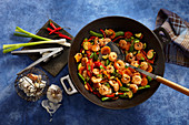 Hot honey prawns cooked in a wok