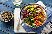 A Buddha bowl with garlic and honey chicken, vegetables and quinoa