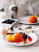 Vanilla peaches with sabayon and marinated blackberries