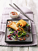 Prawn and Chinese cabbage spring rolls with a curry and chilli vinaigrette