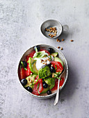 Avocado and grapefruit salad with basil and blueberries
