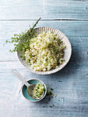 Vegan cauliflower and herb risotto with almonds
