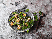 Fried oriental beans and shoots with tofu