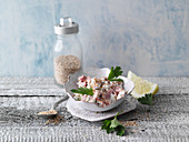 Cottage cheese with tuna fish, sesame seeds and parsley