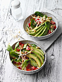 Vegan avocado salad with beansprouts and pine nuts