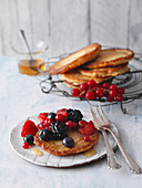Coconut pancakes with fresh berries and agave syrup