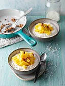 Caribbean coconut dessert with mango and pine nuts