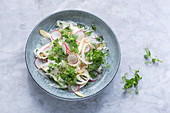 Raw asparagus salad with pea sprouts and radishes
