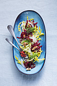 Yellow dandelion salad with beetroot and a chia dressing