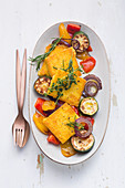 Juicy polenta slices with grilled vegetables