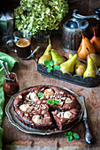 Chocolate cake with pears and frangipane