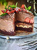 Chocolate mousse cake with strawberries and bananas
