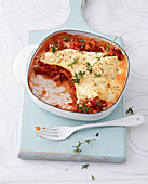 Low-calorie lasagne with tartare and tomato sauce and white sauce