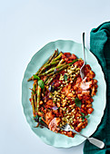Trout fillets with tomatoes, beans and green asparagus