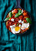 Mediterranean fried tomatoes and peas with chorizo and eggs