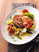 Saltimbocca on a fig salad