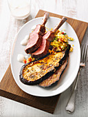 Lamb chops on pepper and bulgur wheat salad with roasted aubergines