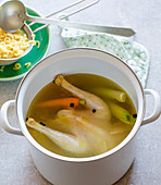 Chicken broth with soup noodles