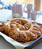 Cinnamon bun wreath with sugar nibs