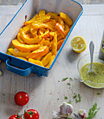 Oven-baked potato wedges in a baking dish