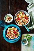 Gluten-free Panzanella salad with chicken and pasta
