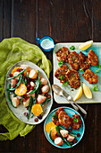 Gluten-free mini pork schnitzel with orange and potato salad