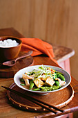 Ginger tofu stir-fry with asparagus and snow peas
